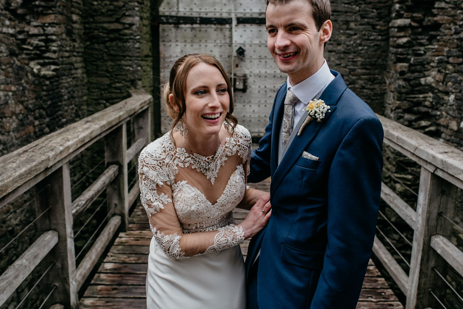 Happy bride laughing during portrait session at Caerphilly Castle