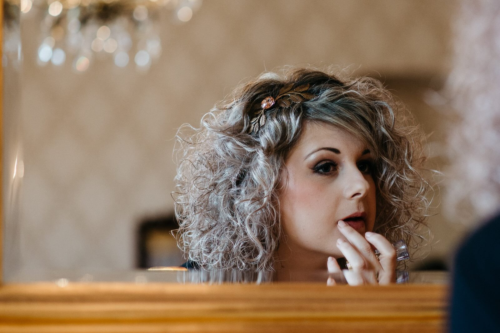 Alternative bride putting finishing touches to her make up at New House Hotel in Cardiff