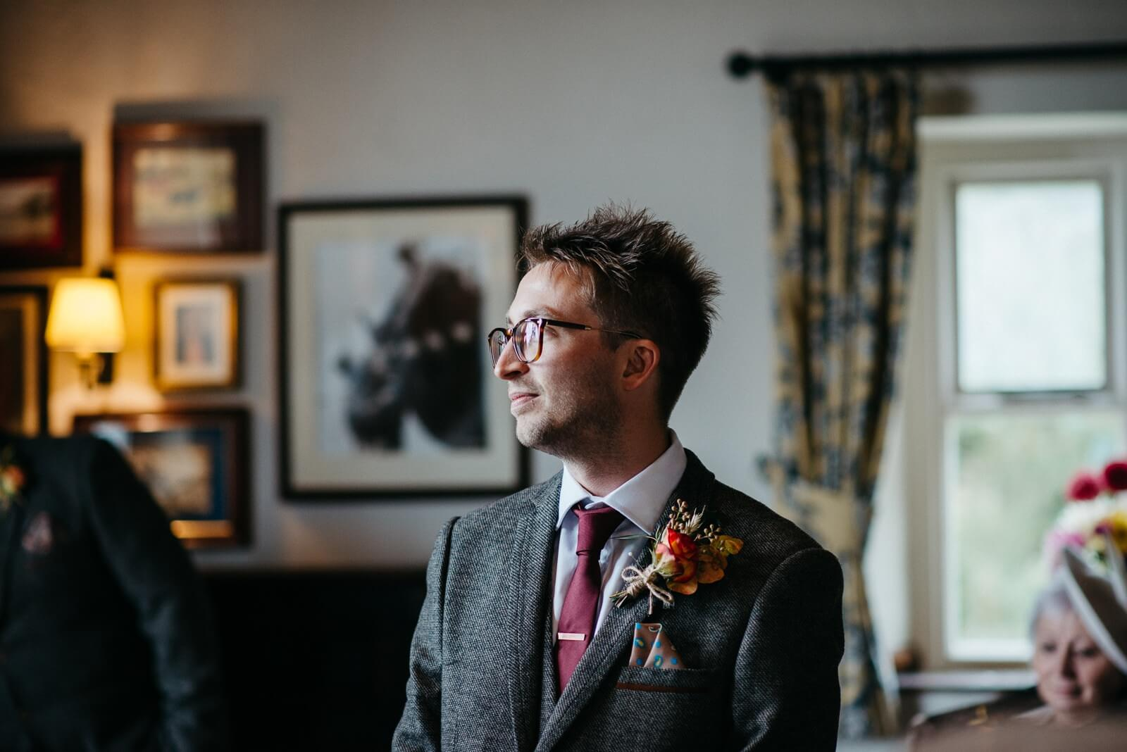 Quiet portrait of groom awaiting his autumn bride at Ty Mawr Cardiff