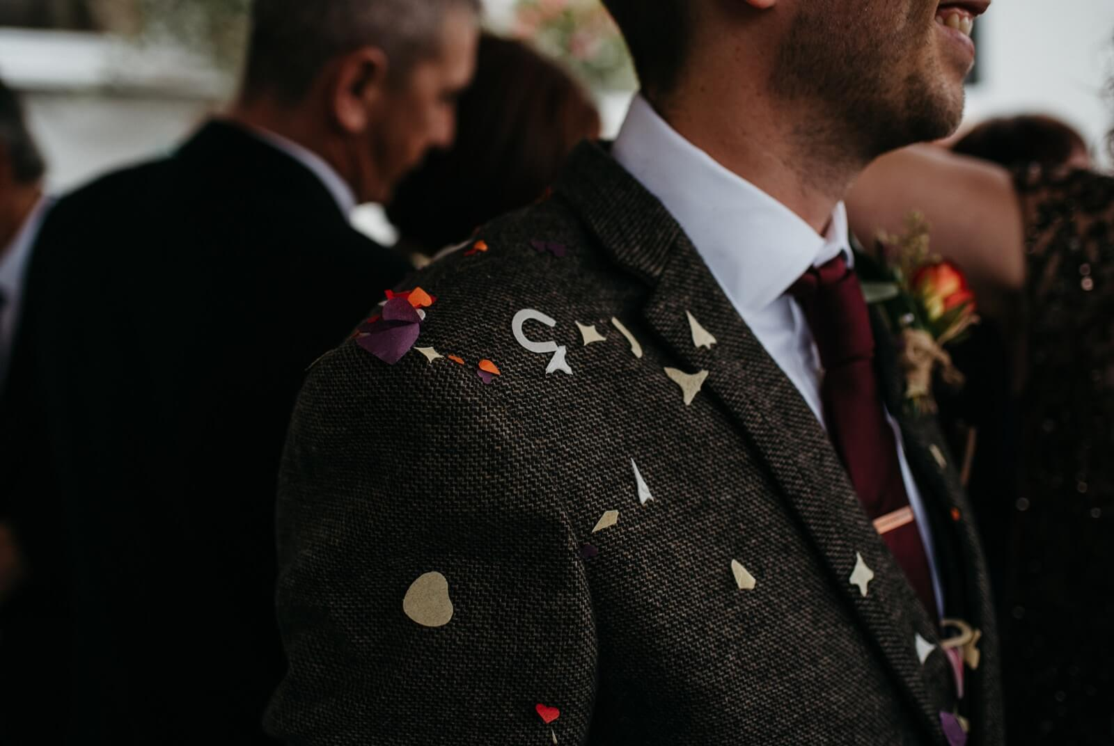 Flecks of confetti left on Cardiff grooms suit after gauntlet at Ty Mawr