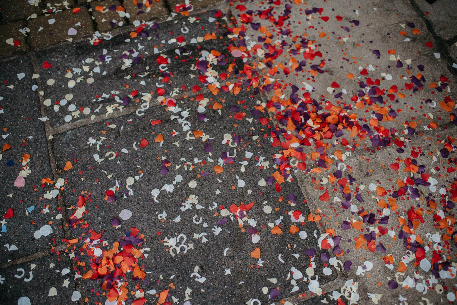 Orange red and purple confetti at alternative autumn wedding ay Ty Mawr, South Wales