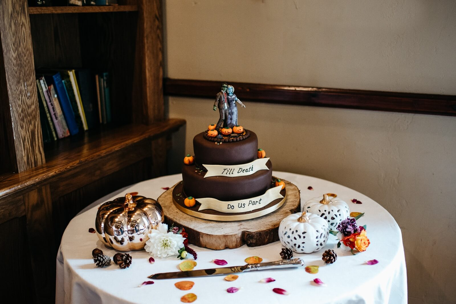 chocolate cake with halloween zombie cake toppers at alternative cardiff wedding