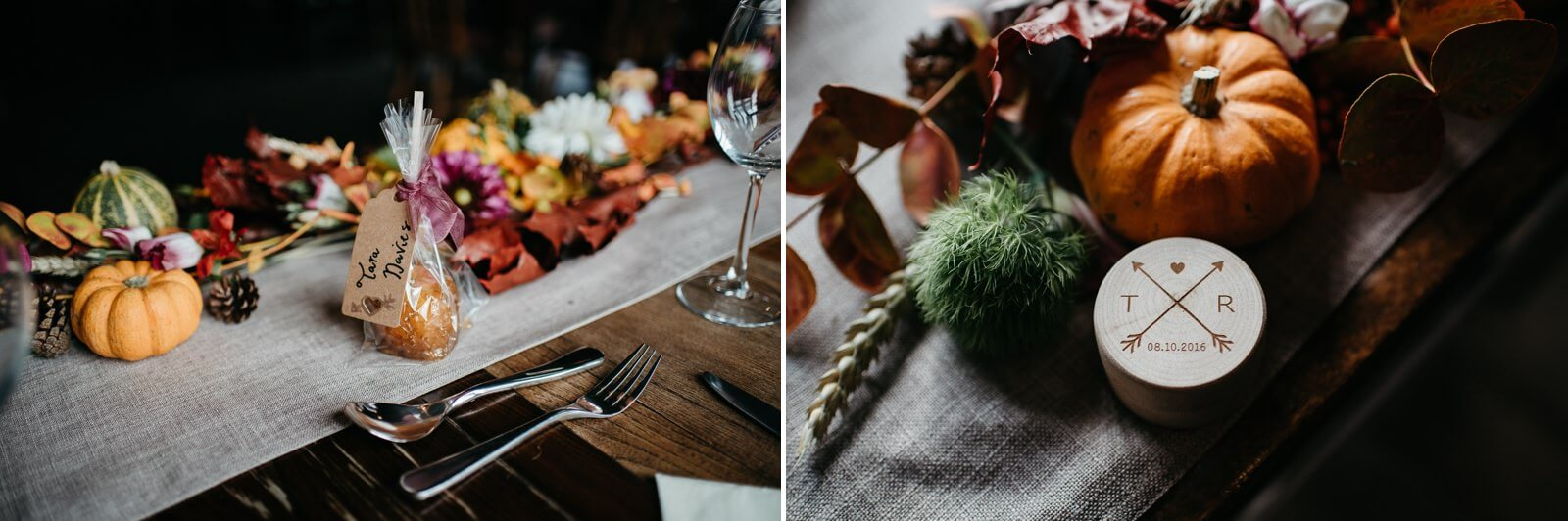 Autumn wedding decor details featuring mini pumpkins or munchkins, conkers, leaves, and pinecones on top of a hessian table runner