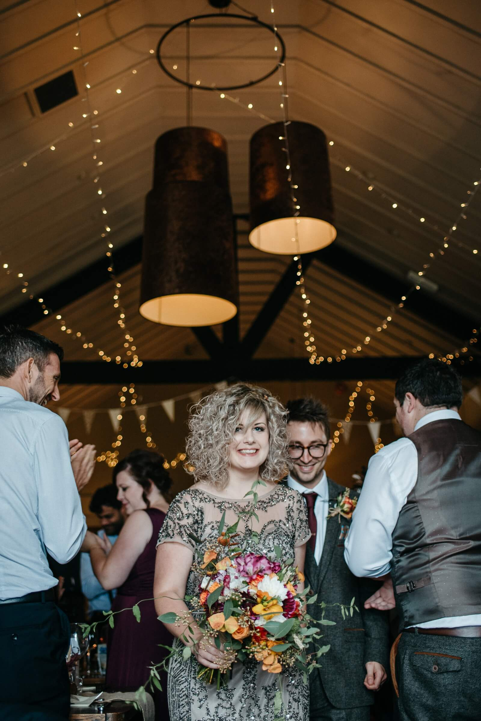 Happy bride and groom at alternative autumn wedding in Cardiff
