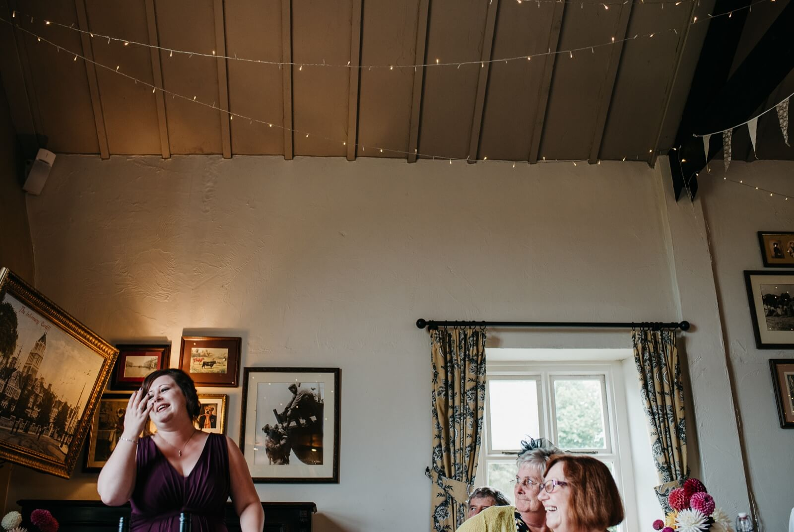 Brides sister and maid of honour delivering a speech to Ty Mawr wedding guests at autumn alternative wedding