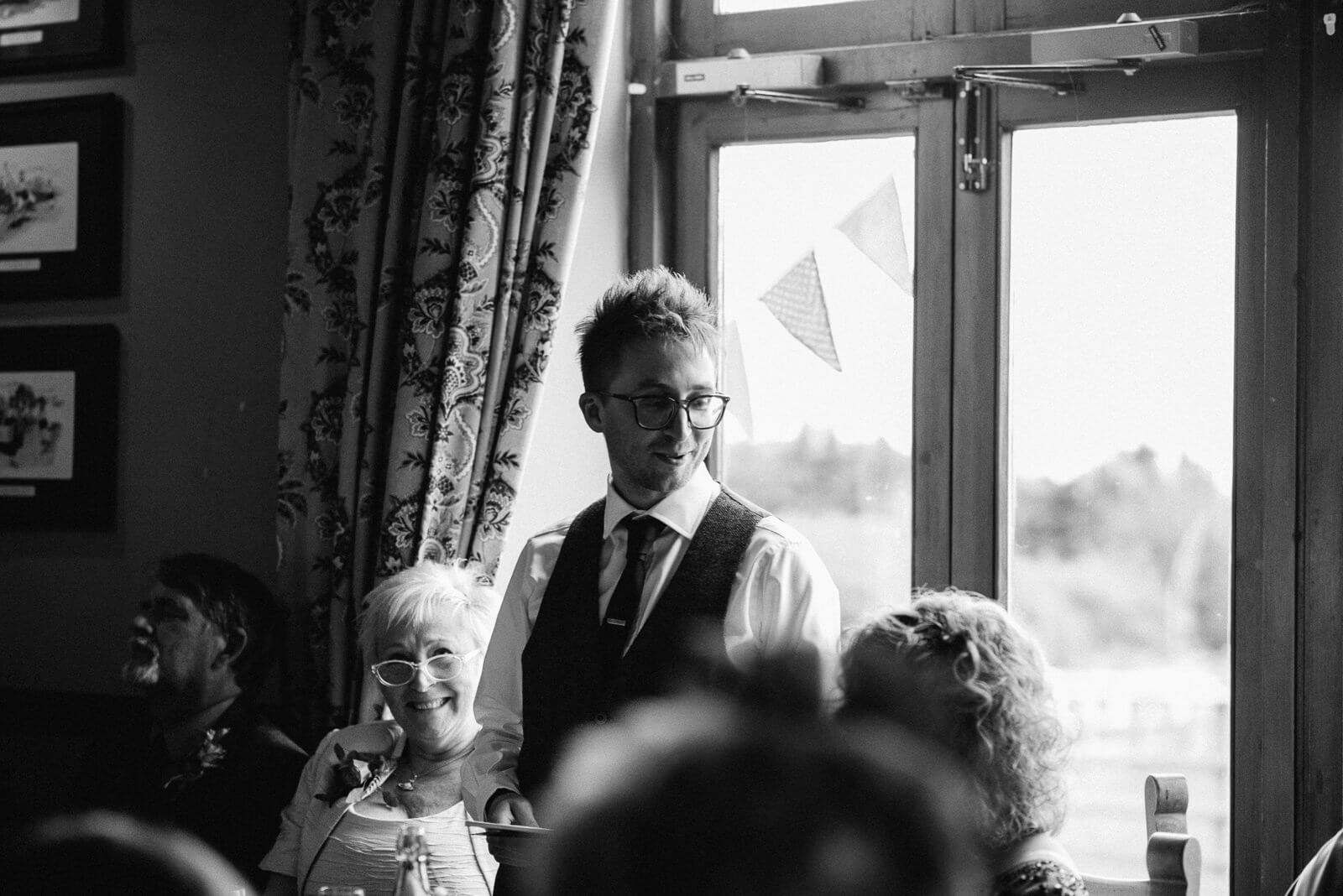 Groom looking lovingly at his new wife during his speech at Alternative Cardiff Wedding
