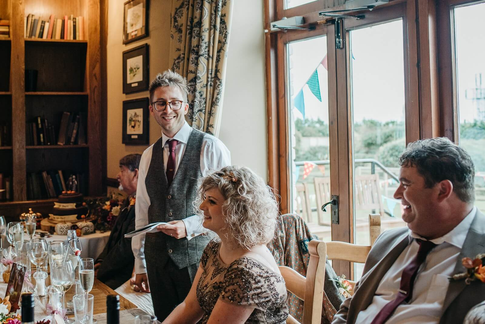 Cardiff Groom delivers his speech at autumnal halloween inspired wedding at Ty Mawr