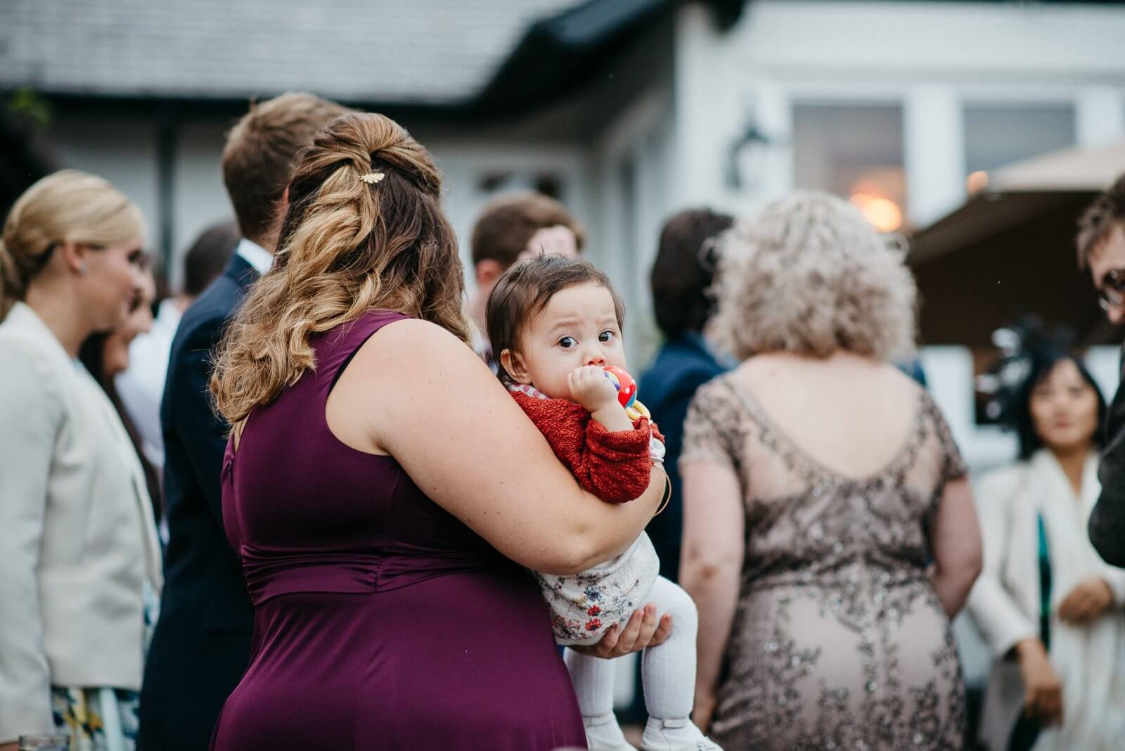 Bridesmaid holding baby at Ty Mawr wedding