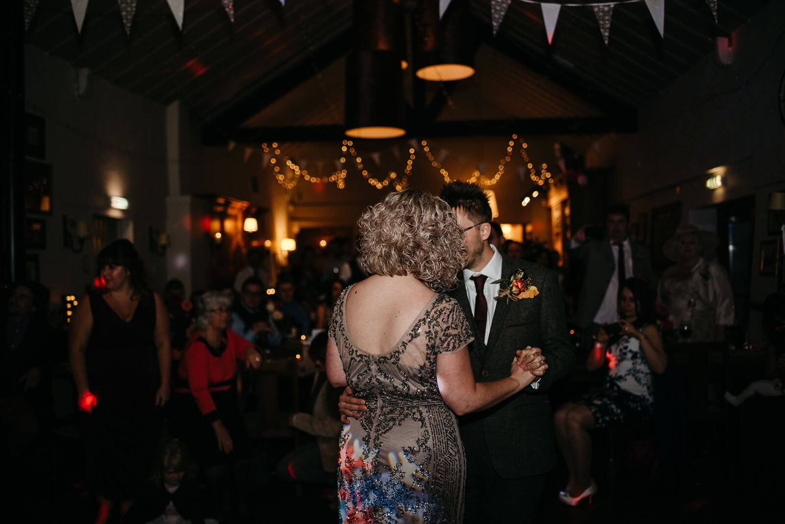 Bride and Groom dancing to Foo Fighters 'overlong' as their first dance in fairy lit barn at Ty Mawr Wedding, Cardiff