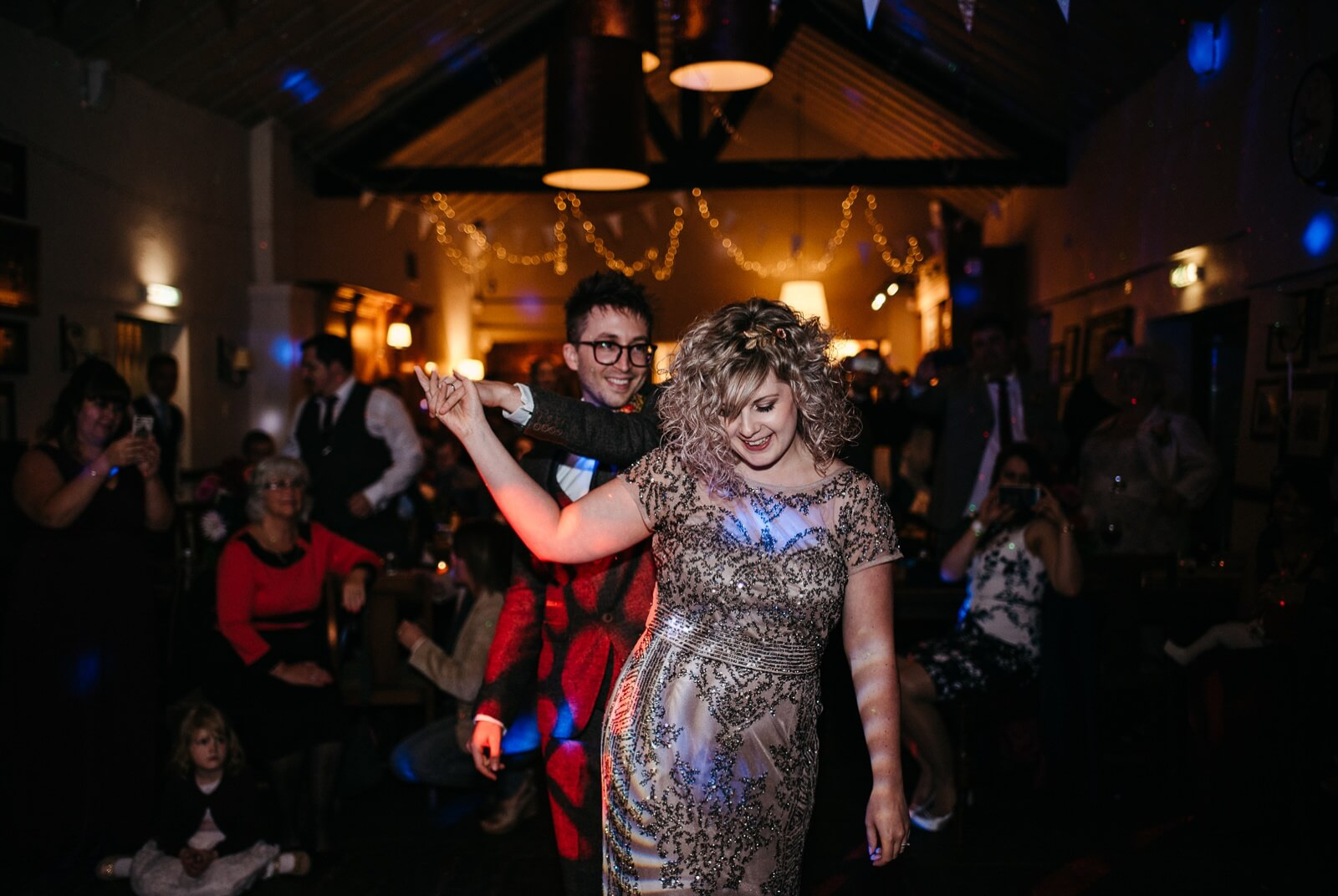 Bride and Groom during their first dance in fairy lit barn at Ty Mawr Cardiff