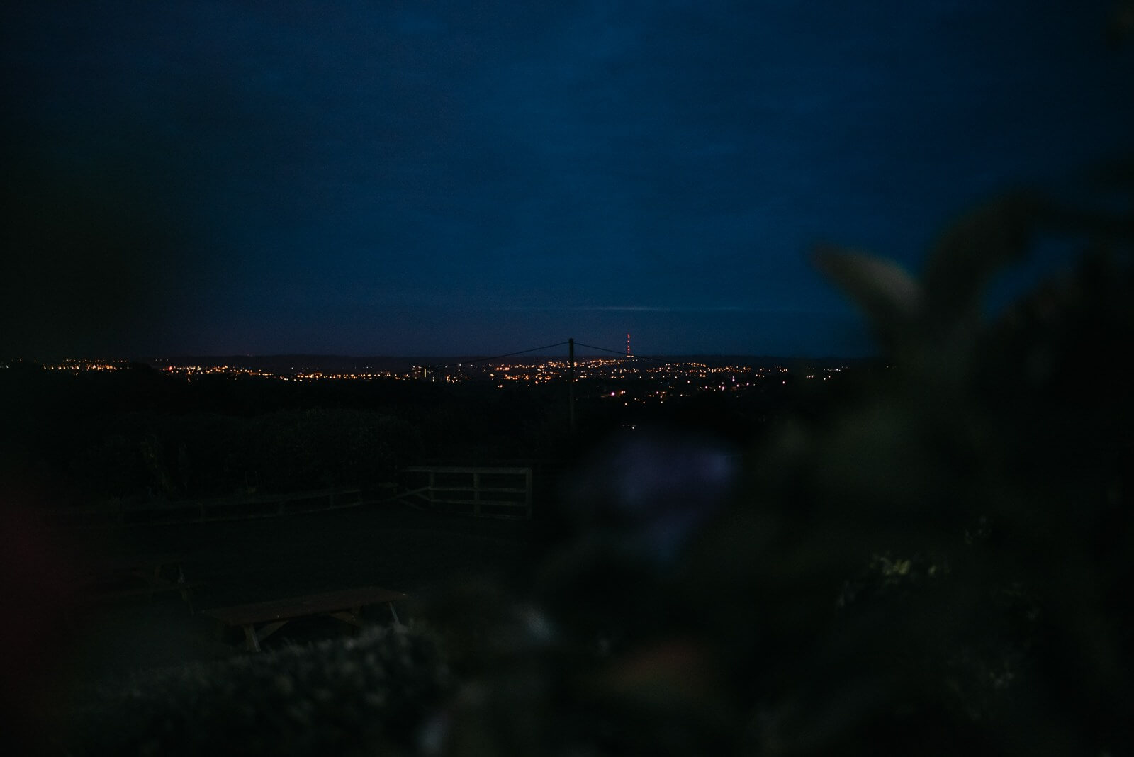 Night time photograph of Cardiff skyline with Severn Bridge in the distance taken from Ty Mawr wedding