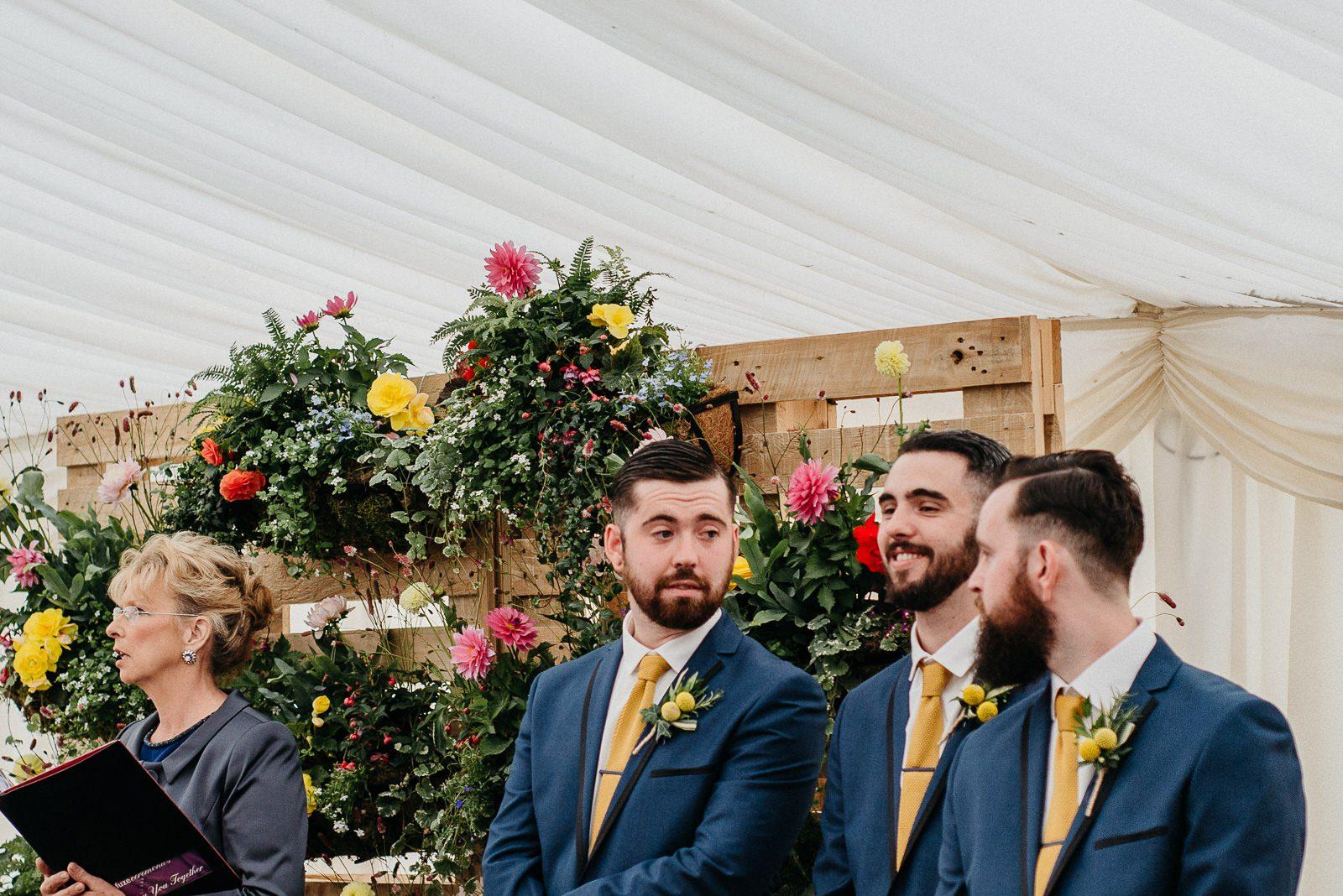 Groomsmen waiting on Bride