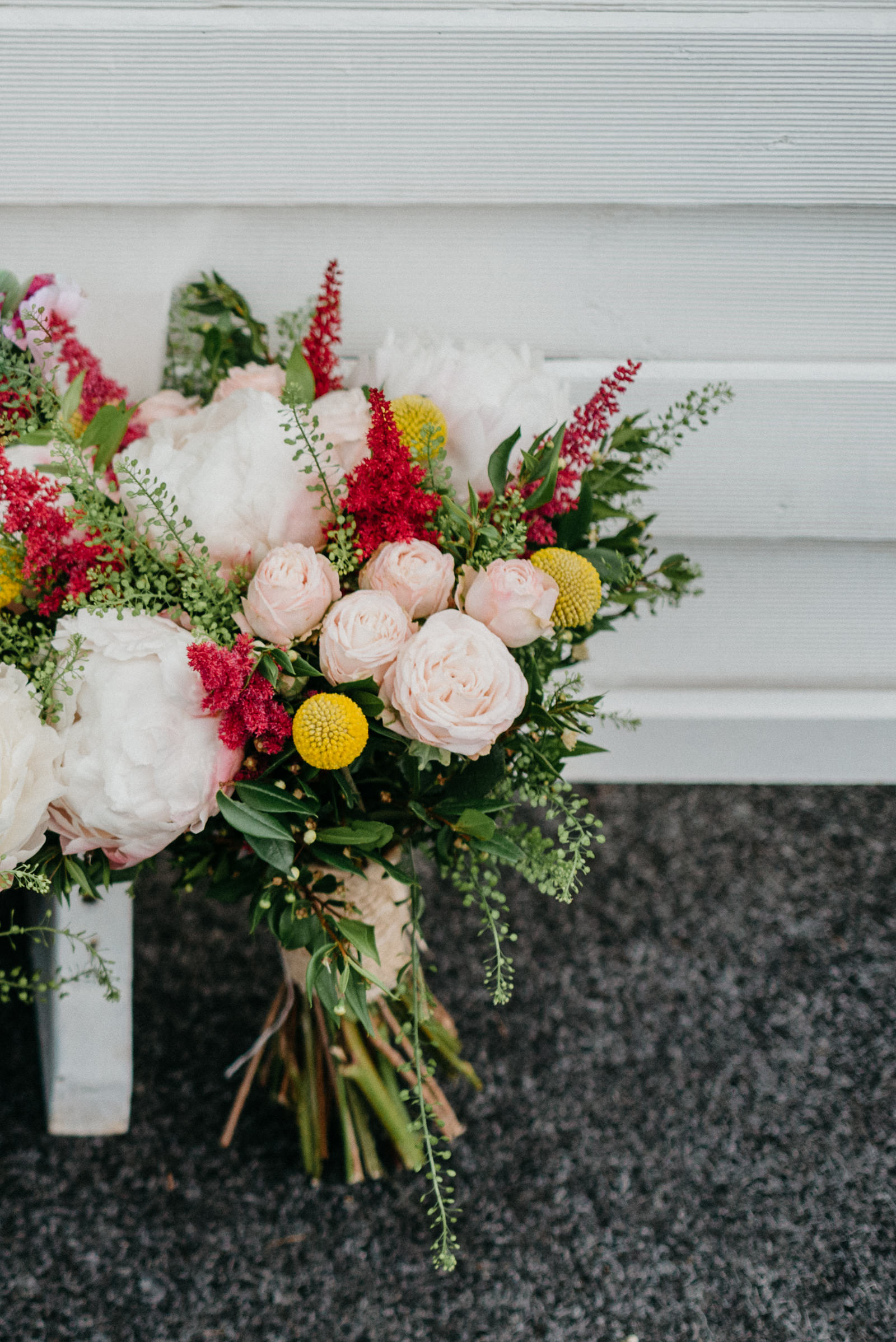 Brides bouquet of pale pink peonies and roses, astilbe and Craspedia