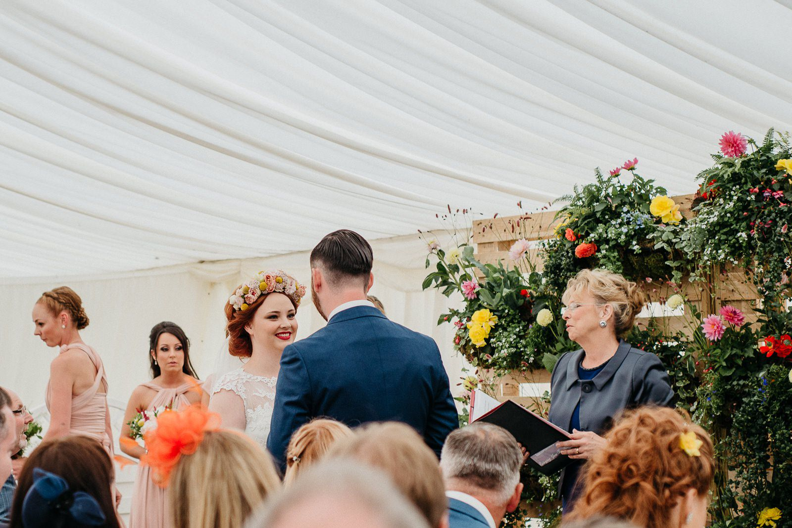 Bride smiling at groom at beginning of wedding ceremony