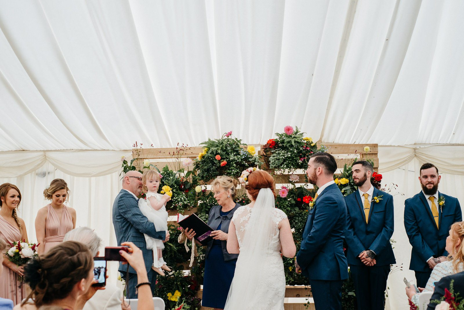 couples daughter passes rings during Ayrshire Ceremony in Scotland