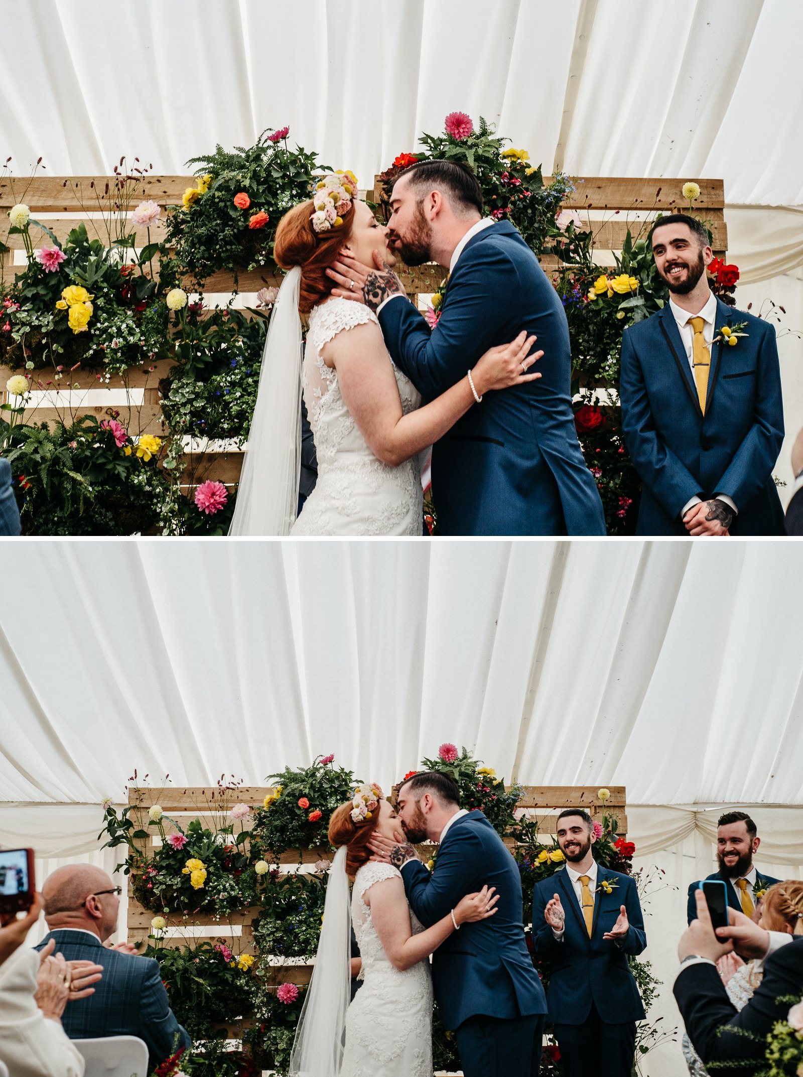 Bride and groom kiss after exchanging wedding vows