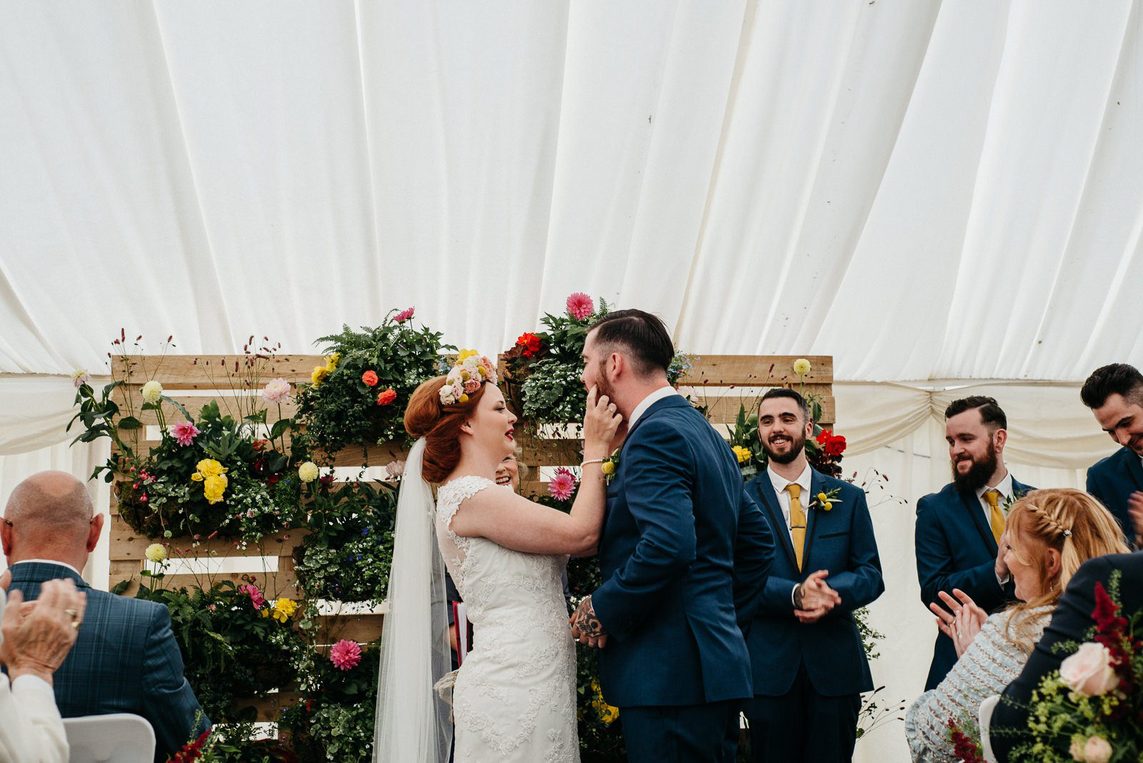 bride wipes lipstick from grooms face at Enterkine house wedding