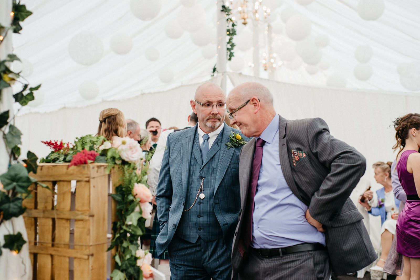 Father of the bride chatting with guests at alternative wedding