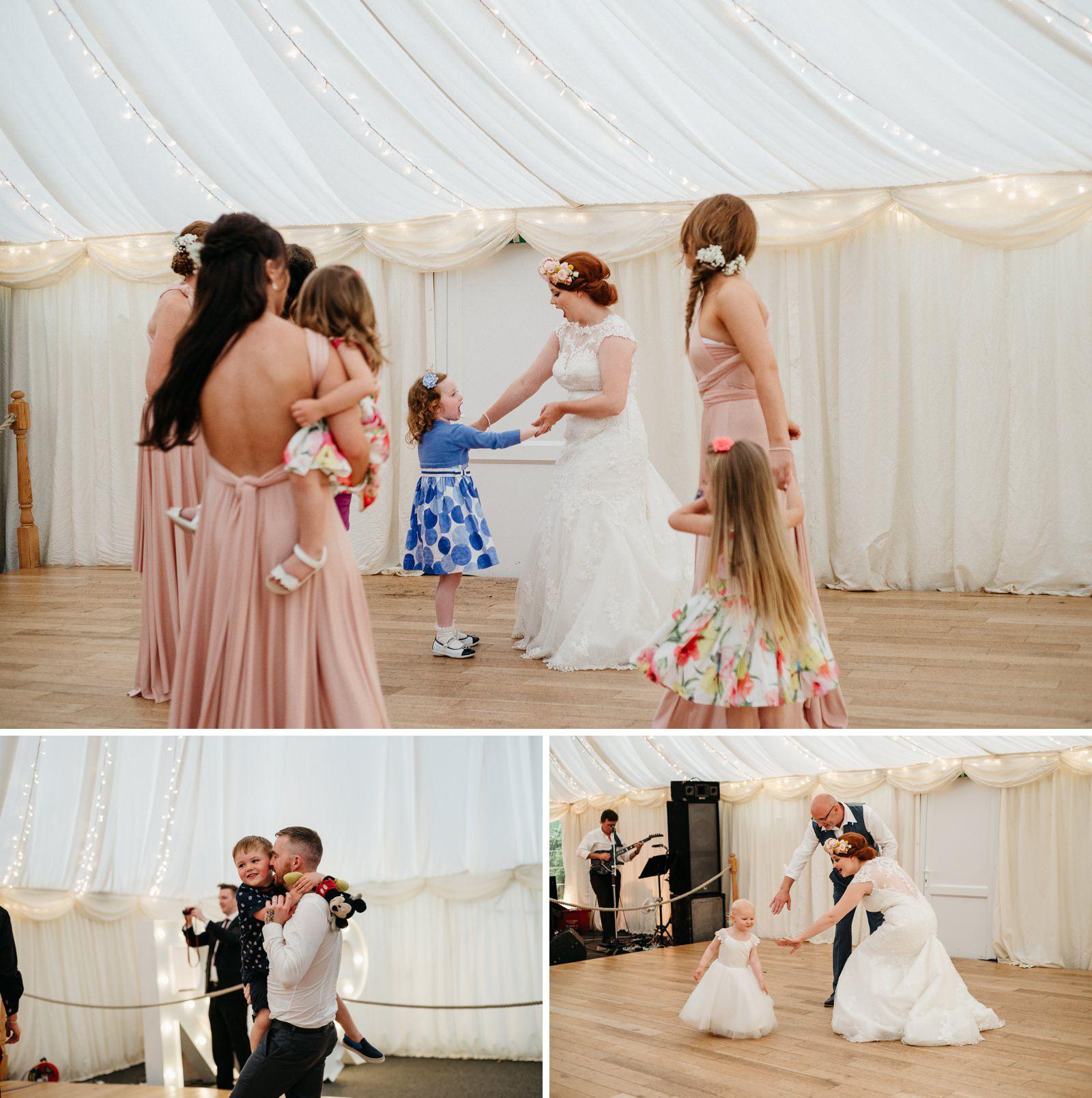 bride and ger bridesmaids dancing