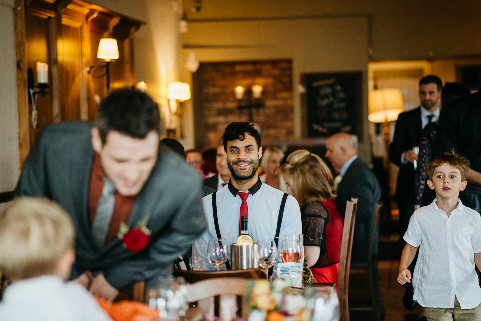 single man at wedding who wasn't given a plus one invitation to keep numbers low