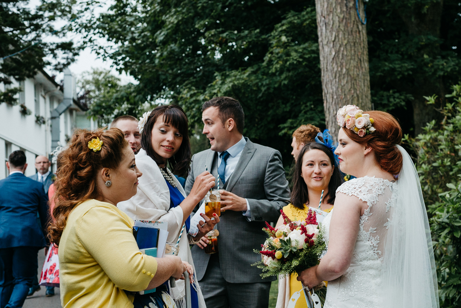 bride chatting to friends who her and her husband invited following carefully guest list planning