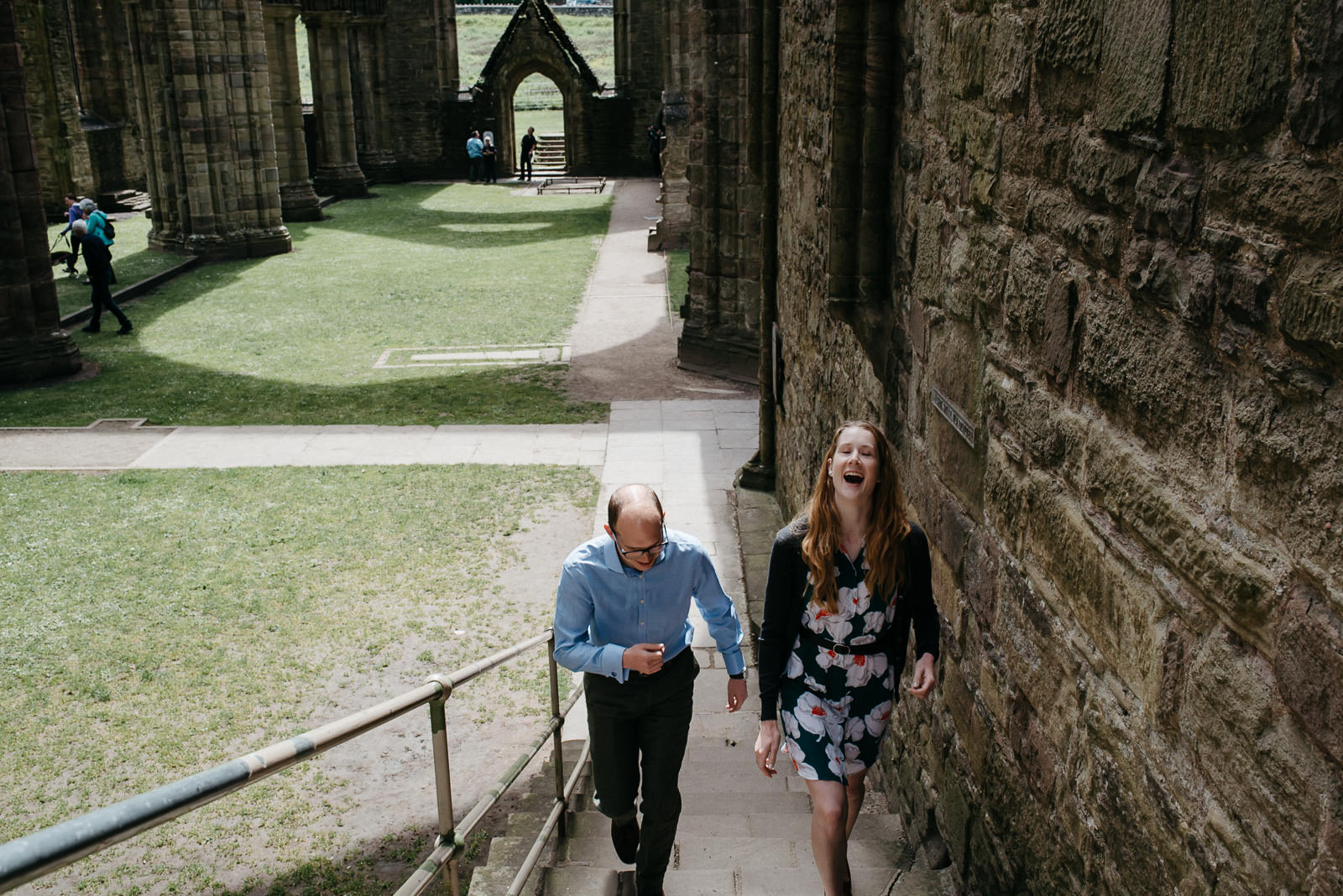 Bride & Groom laughing inside Tintern Abbey in the Wye Valley