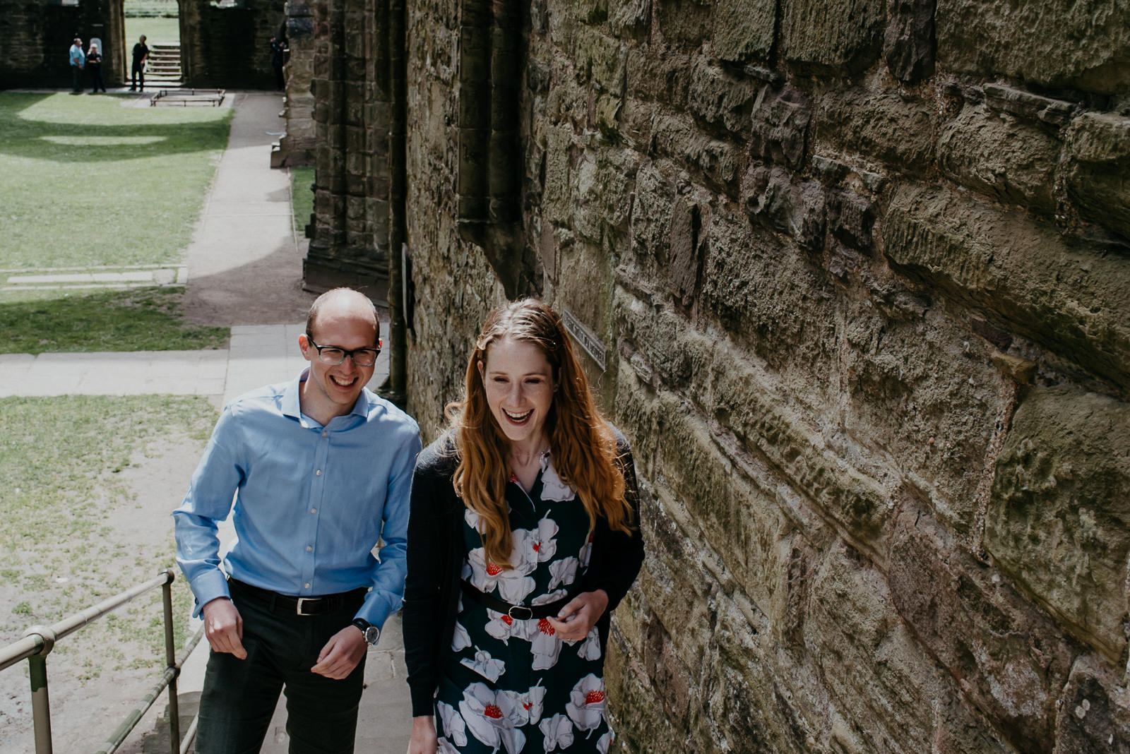 Bride & Groom sharing a joke during their couple portraits at Tintern Abbey