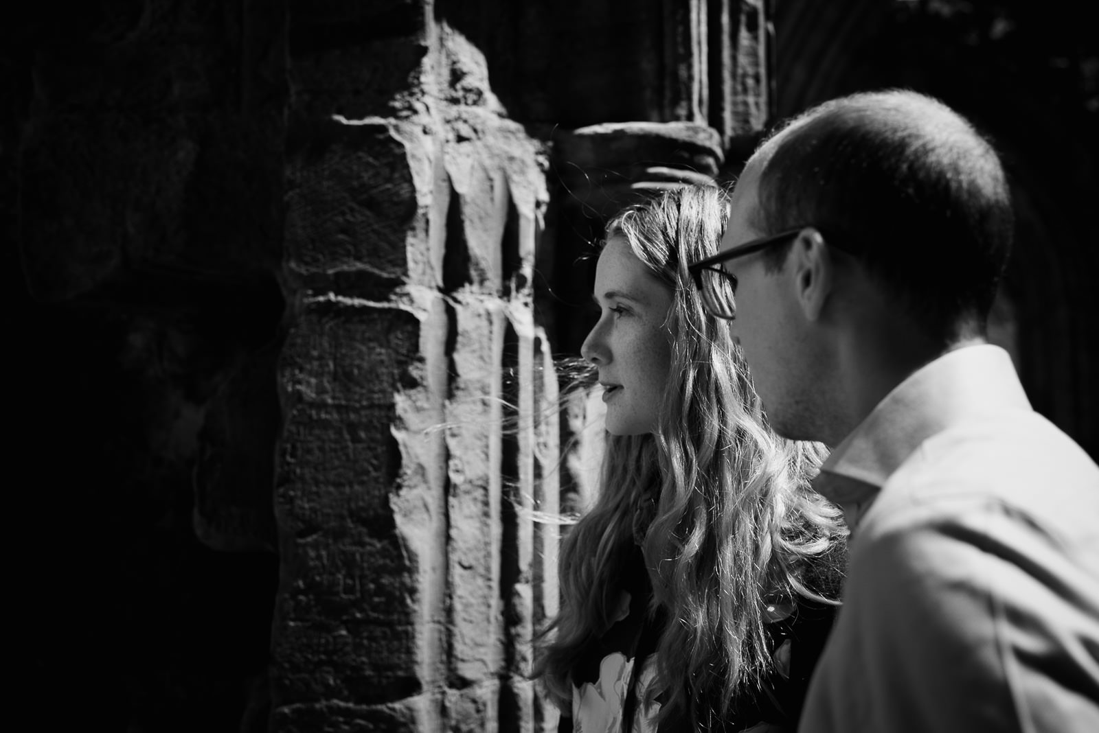 Intense black and white photograph of Bride & Groom looking into the distance