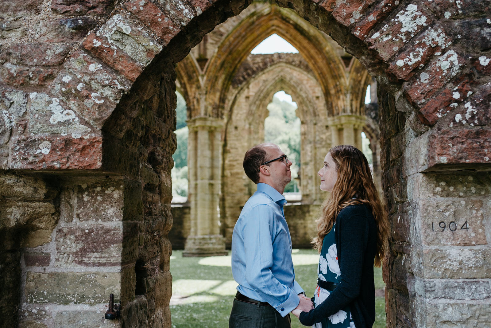 groom laughing during couple shoot at Wye Valley CADW site in Tintern