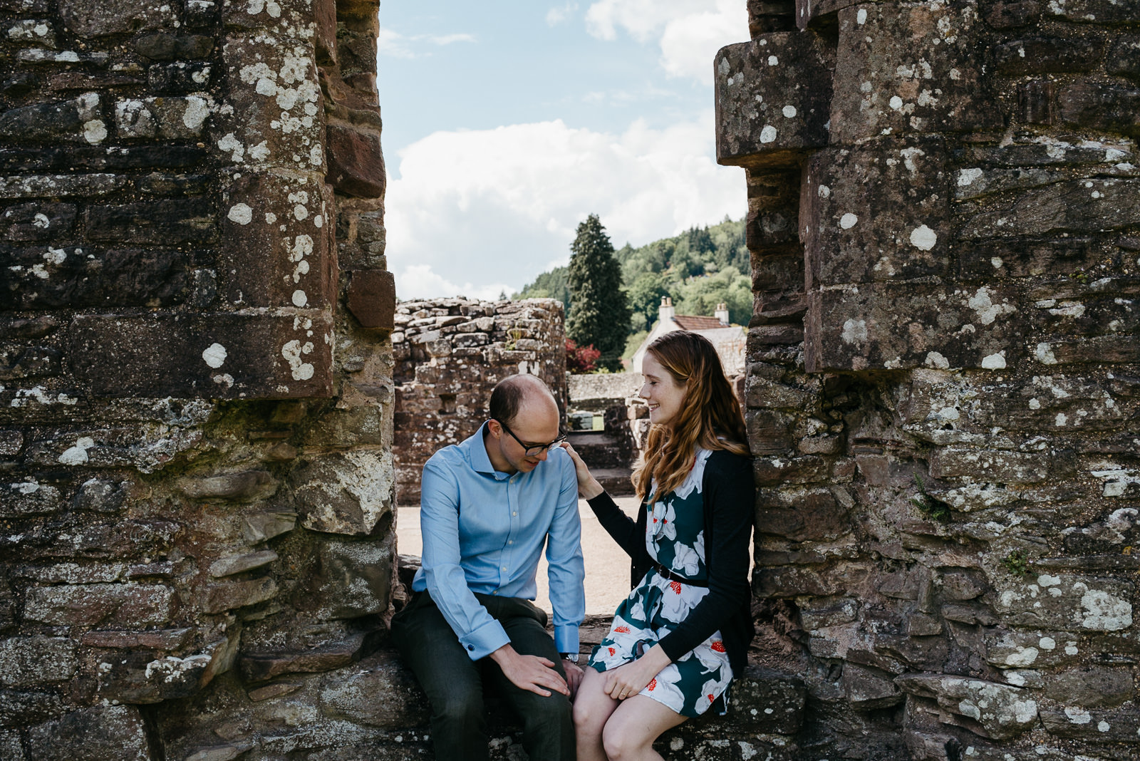 Couple relaxing uring their engagement portraits session in the Wye Valley