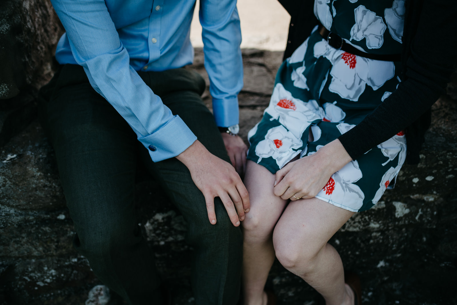Detail photograph of couple relaxing during their portrait session