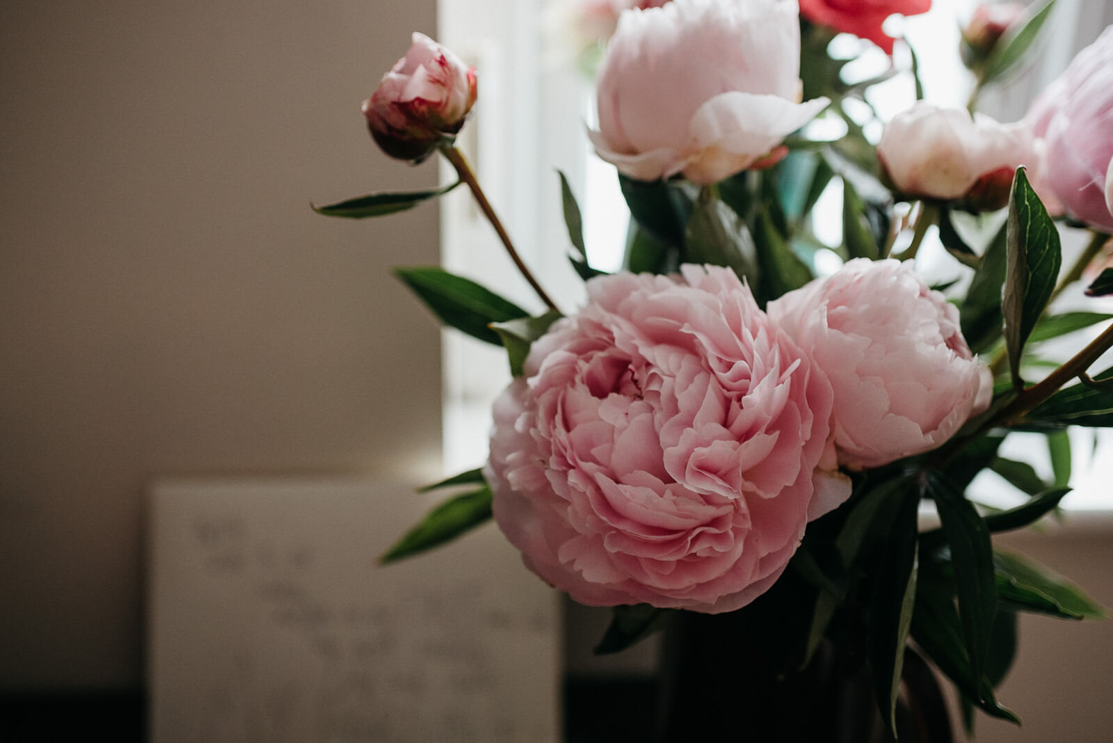 a punch of peonies from groom to his bride