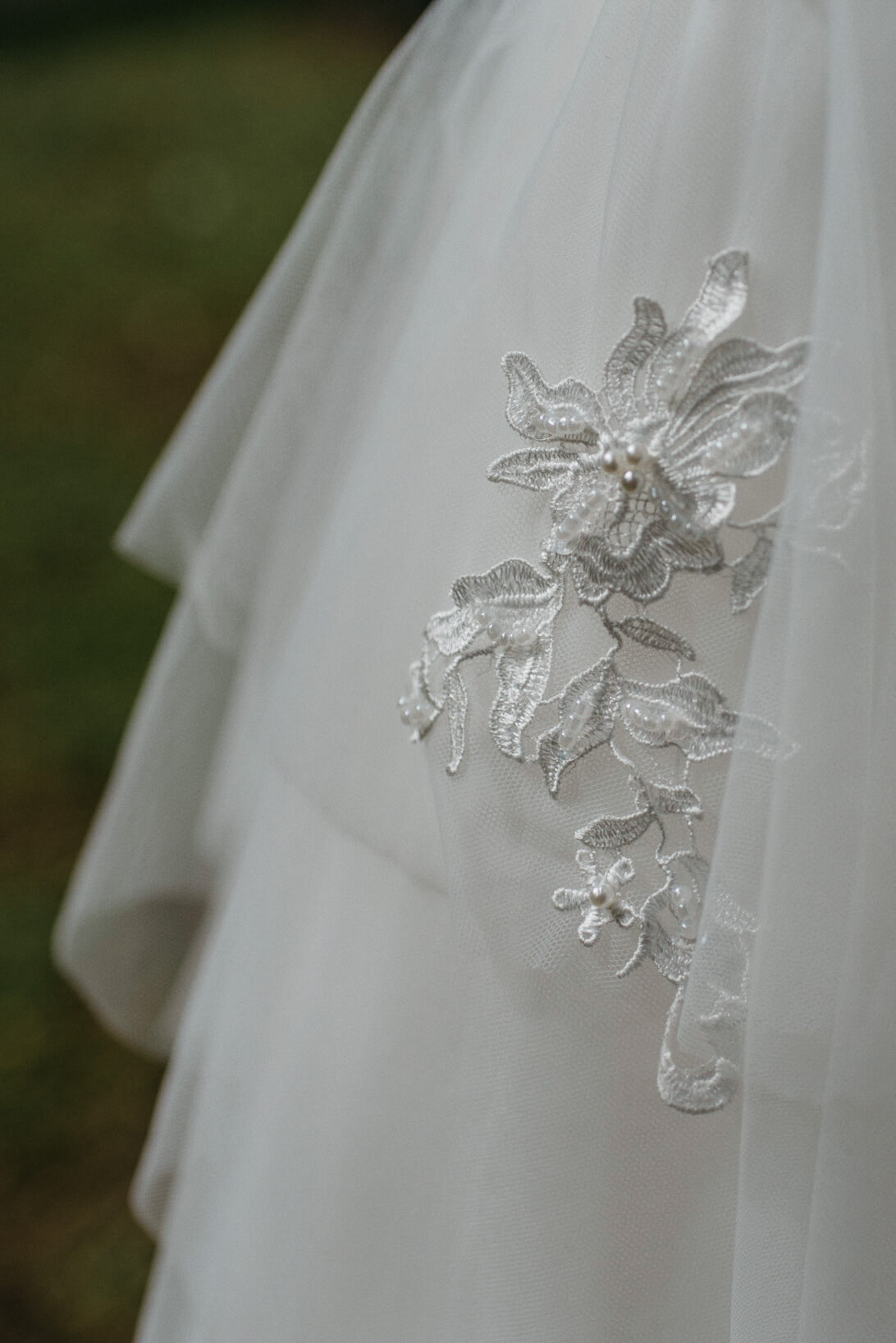 embroidered detail on brides tulle dress