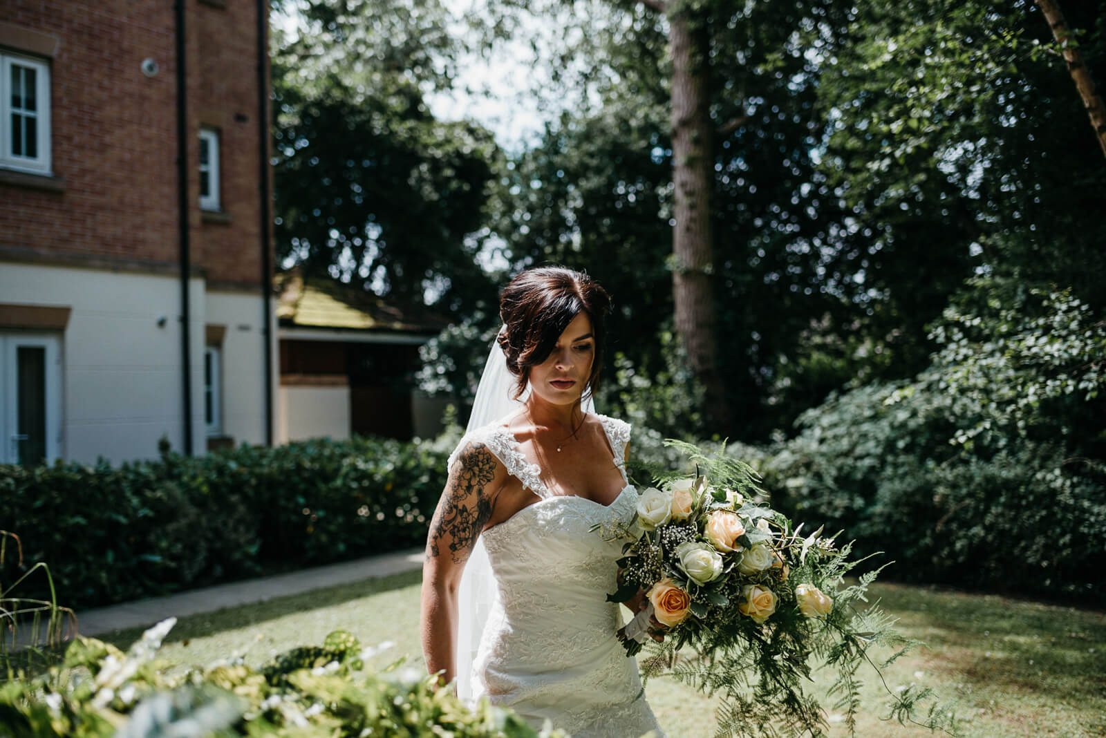 tattooed bride leaving for her modern, contemporary city hall wedding in Cardiff