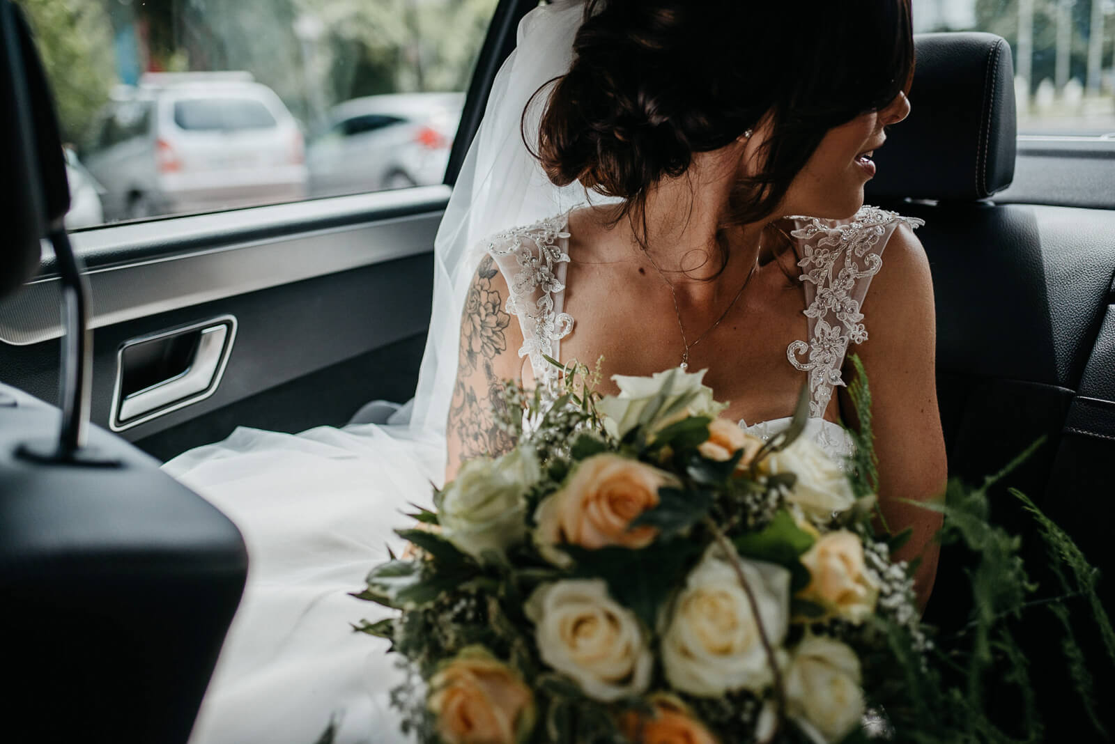 bride catches a glimpse of her groom outside the registry office
