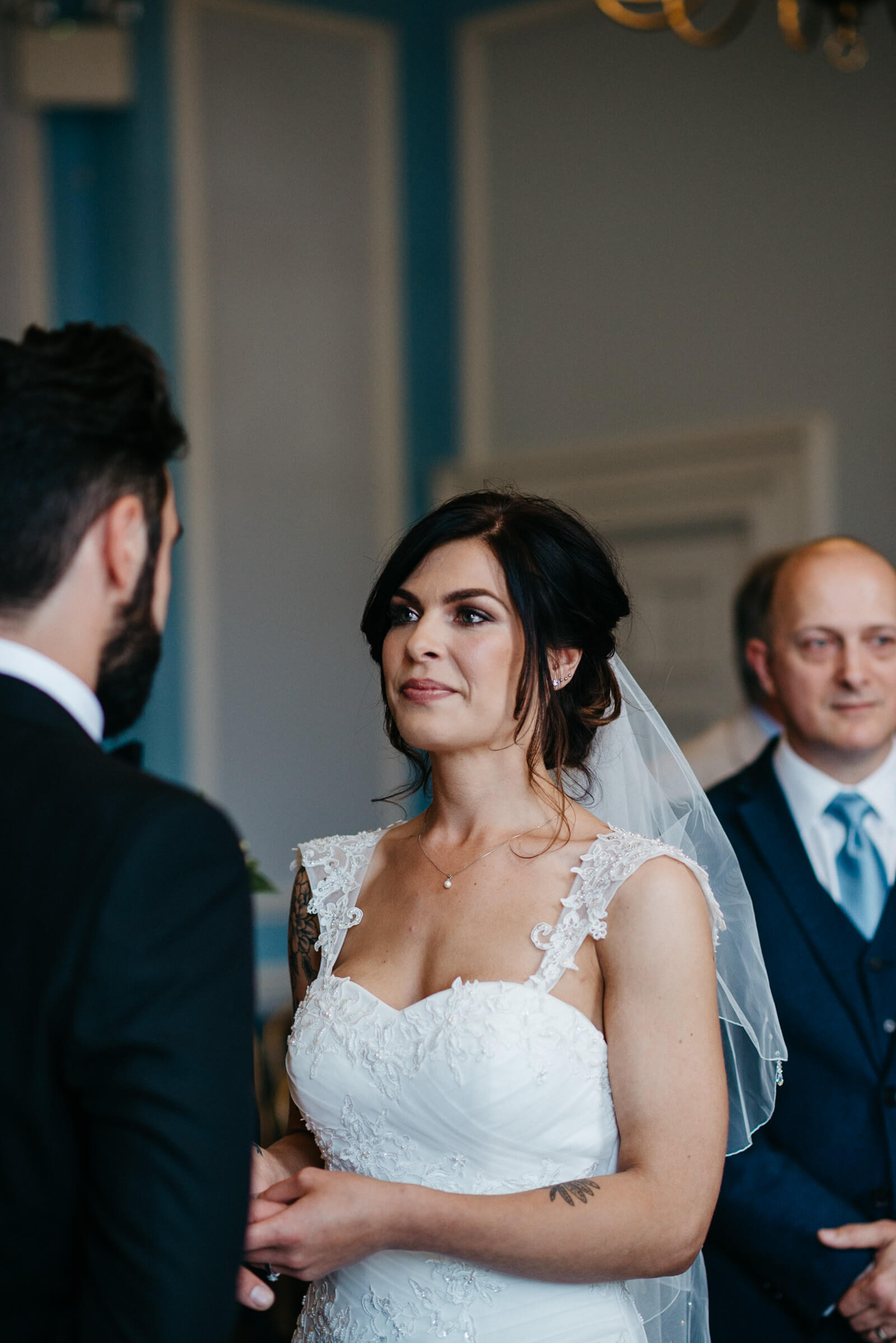bride exchanges wedding vows with groom during intimate and relaxed city hall ceremony
