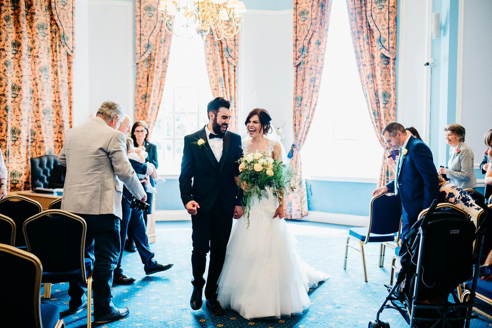 bride and groom walk back down the aisle at cardiff registry office
