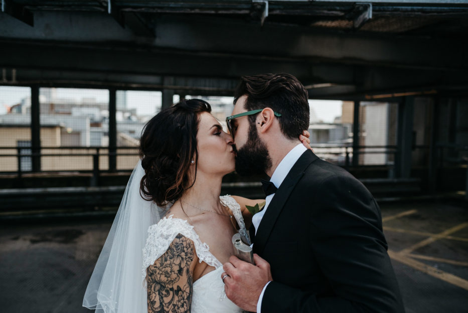 Cardiff Couple kiss on City Rooftop after their Registry Office wedding
