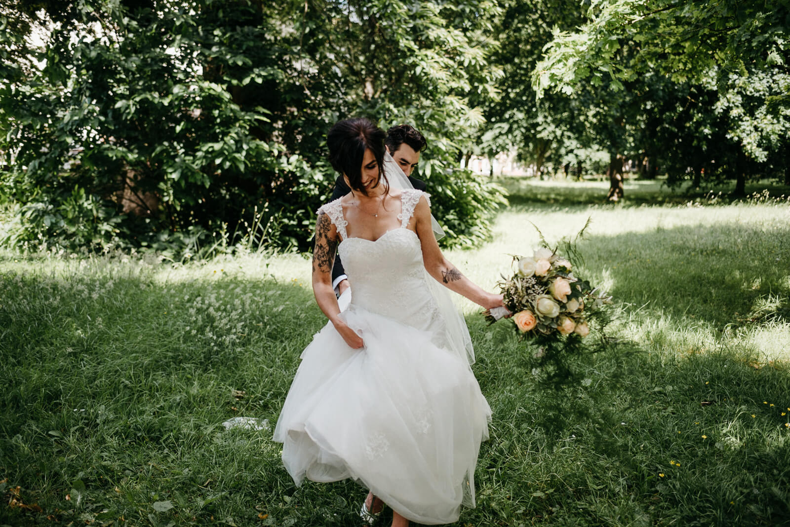 bride walking through the green lush undergrowth in cardiff