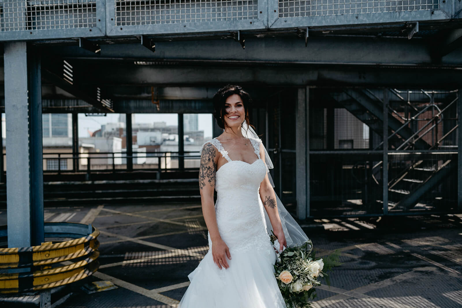 urban rustic industrial portrait of bride on carpark rooftop in the city