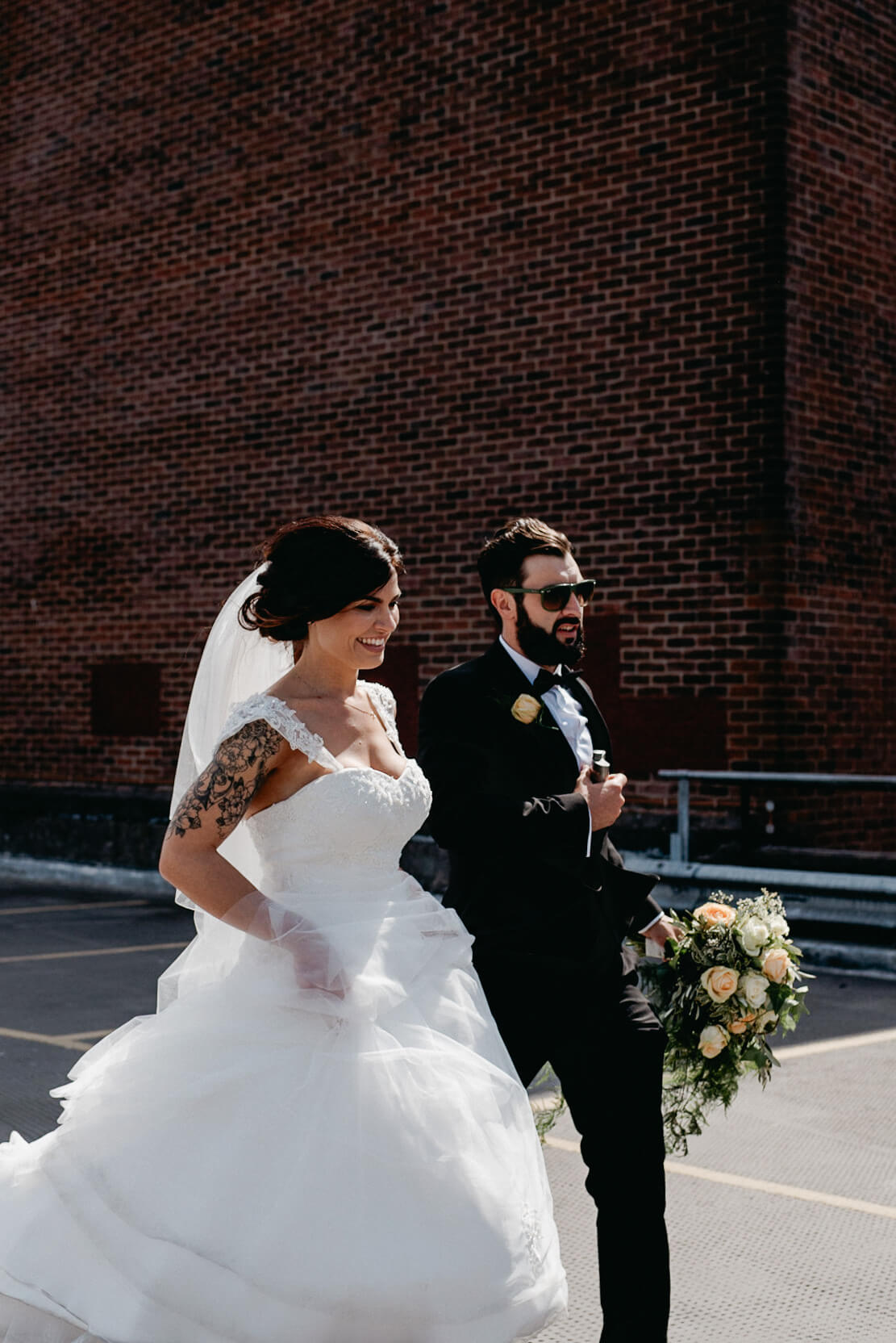 bride and groom on rooftop with new york vibes