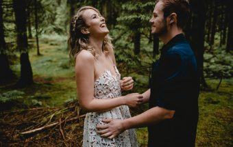 Bride & Groom sharing a joke during their woodland portraits in Somerset
