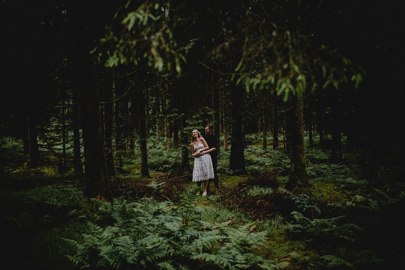 Bride and Groom dancing under the tree canopy in Somerset