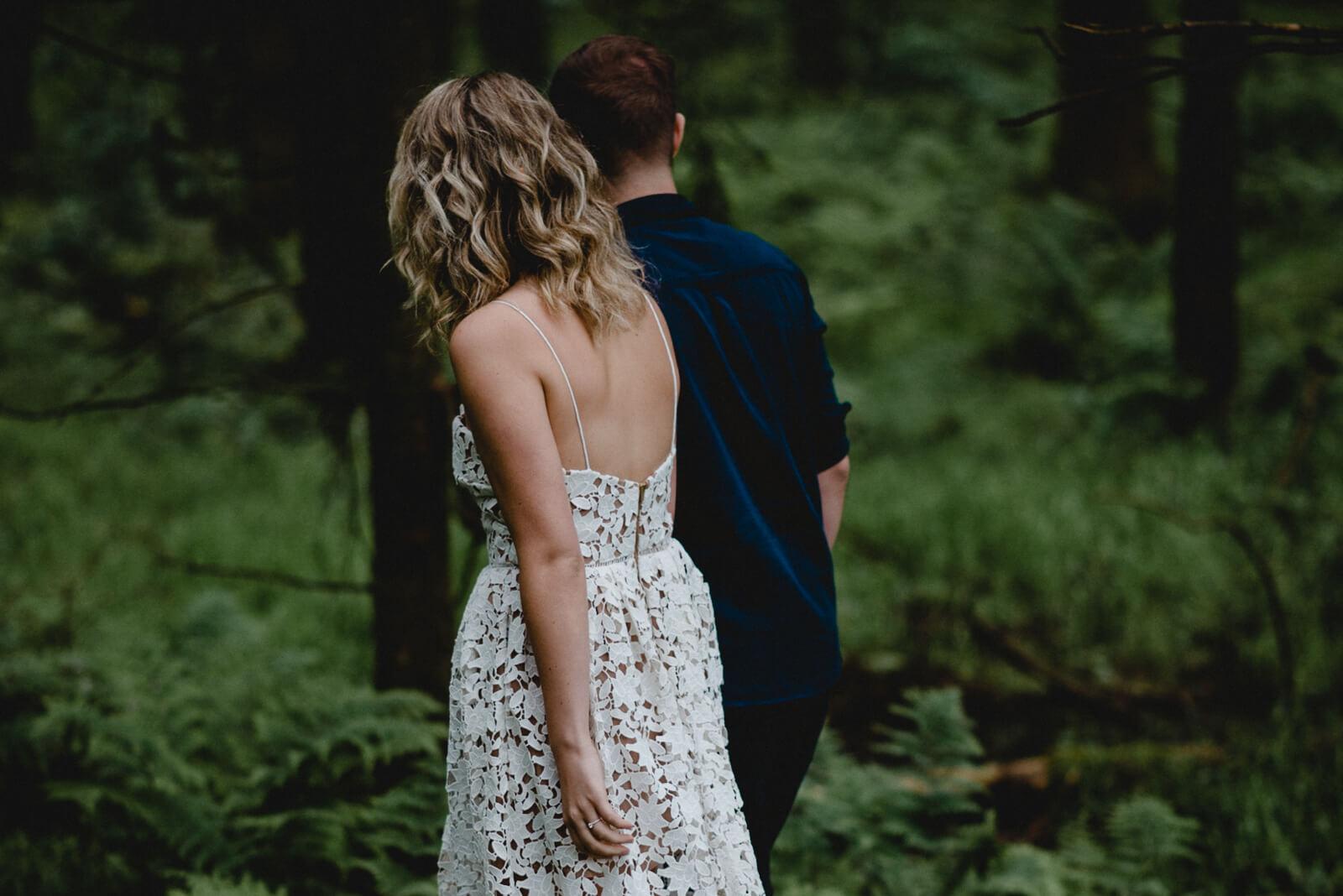 Bride & groom walking through woodland in Somerset