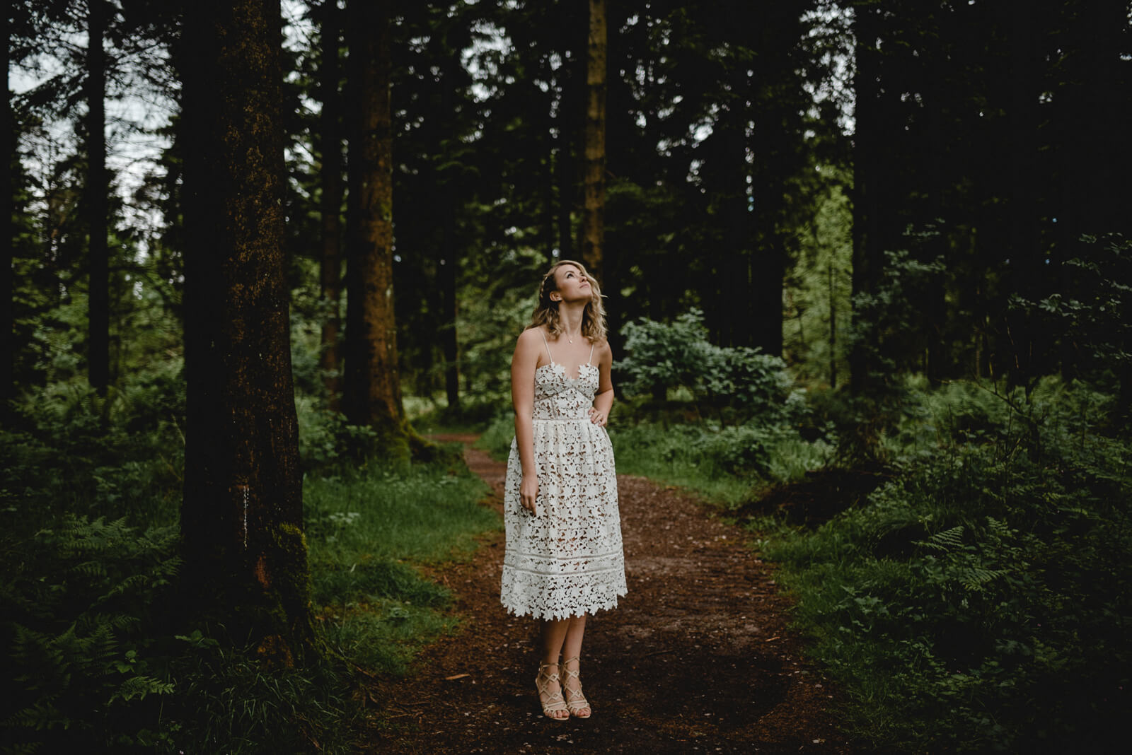 bride wearing self portrait wedding dress in woodland portrait