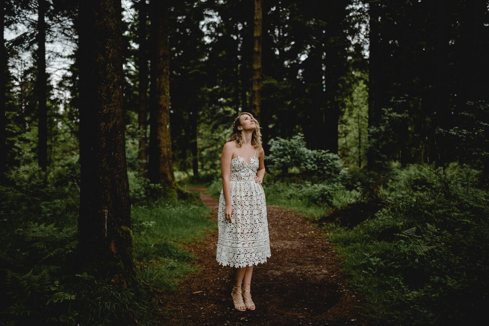 bride wearing self portrait wedding dress in woodland portrait