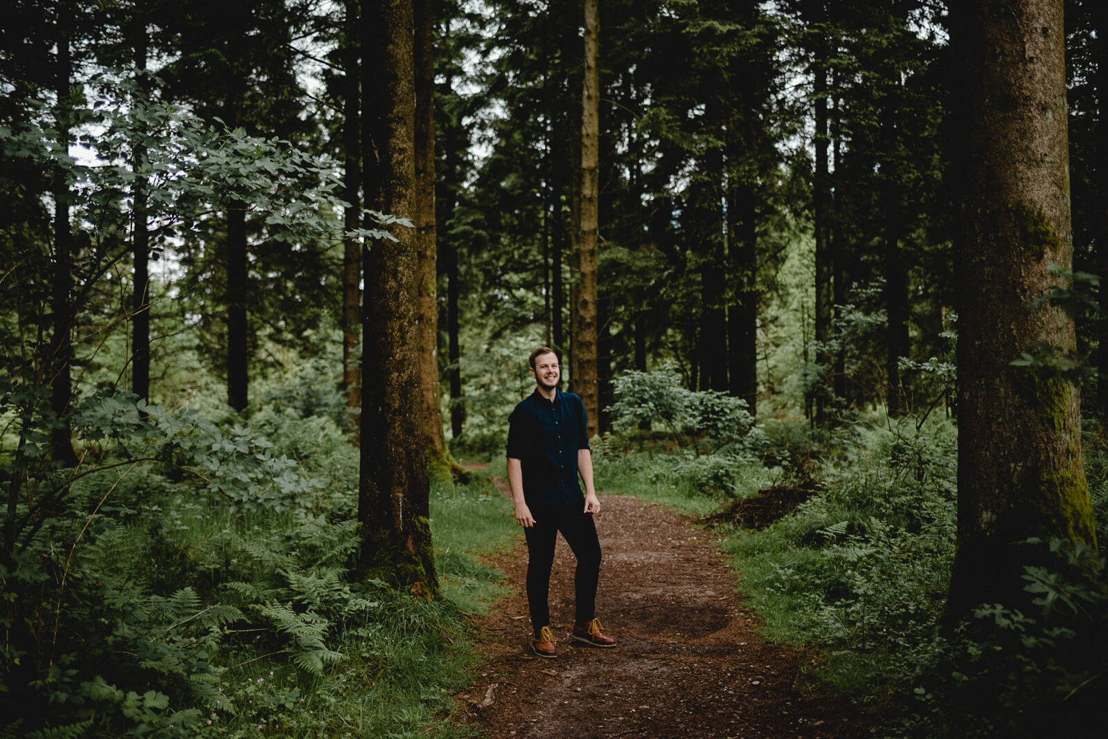 grrom wearing red wings during woodland portrait