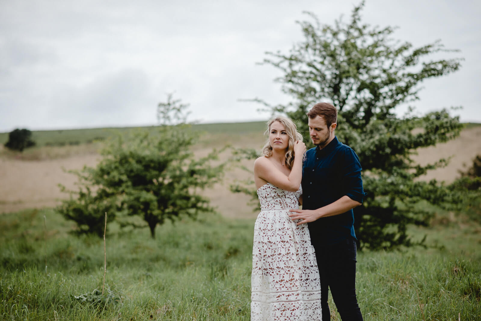 bride and groom in field in Mendip Hills