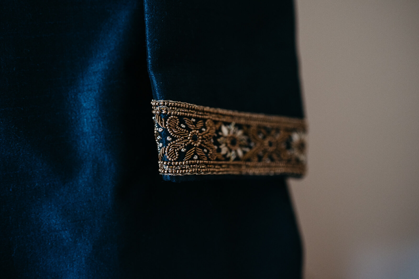 Cuff details of grooms navy silk wedding suit