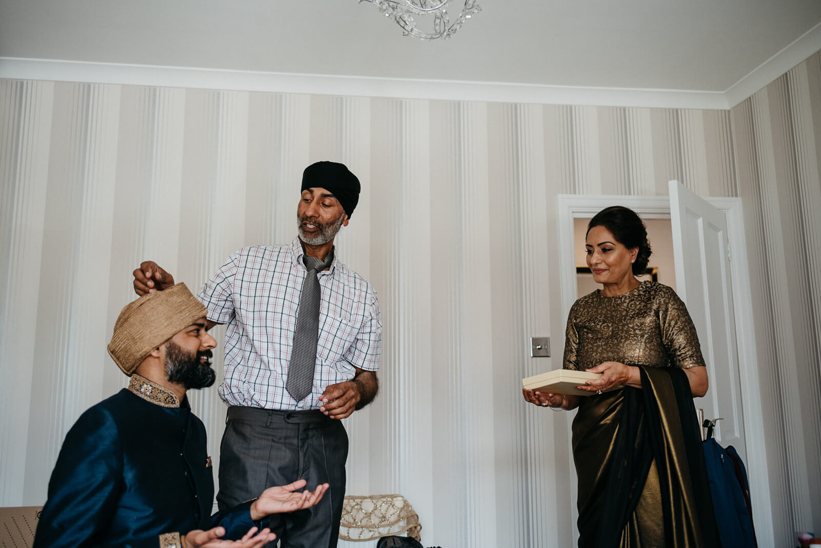 groom chats to his mother before leaving for his wedding at Marylebone One, London